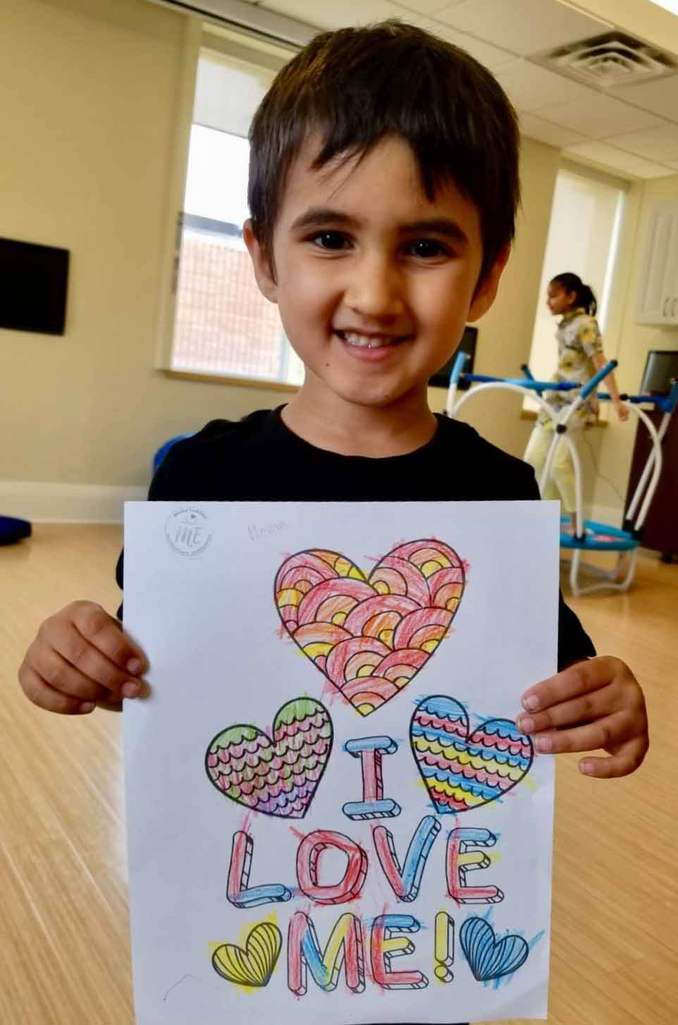 Young participant shows off his artwork in Milton Ontario's The Kangaroo Project